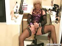 Hot shemale masturbating on chair
