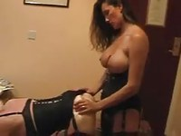 Busty brunette gives a handjob to blondie