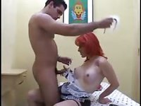 Guy fucking a red haired shemale
