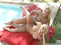 Blondes fucking by the swimming pool