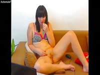 Milf spreads her legs and stuffs her pussy with a dildo