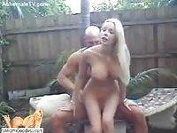 Busty blonde fucked in the garden