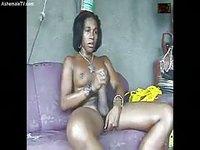 Busty ebony Trans stroking her mighty dick