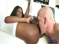 Black bitch uses her dick into a white man's ass