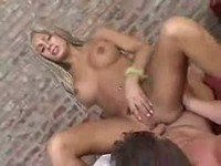 Muscular dude pounds a blonde tranny