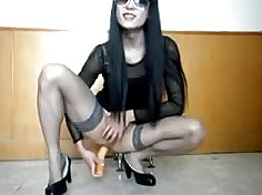 Classy crossdresser jerks her cock on an office chair