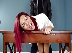 This redhaired shemale slut bent over the desk and fucked in the ass