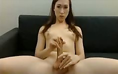 Cute slim tranny milking her big cock while fingering her perfect ass