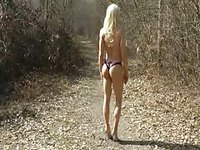 Hot blonde tranny with awesome body showing off outdoors