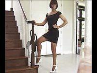 Pretty tranny in black dress shows off her body