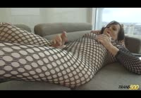 Thick bottom well hung tranny in a fishnet bodystocking