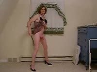 Up and coming older transsexual housewife Debbie Heart modeling her big dick and tight ass