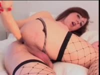 Delightful college aged shemale Farrah Mills  using a huge fake cock to pleasure her snug ass