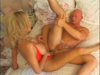 Mature shemale stunner Gia darling in a tiny red bodysuit sucking and fucking a bald dude