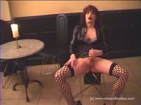 Older amateur transsexual whore Lady Victoria dressed in stockings while jerking her big cock