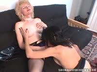 Older shemale slut Lisa Love exchanging oral favors with a well endowed fresh-faced tranny
