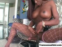 Stunning ebony amateur transsexual cougar Nefertiti exposing her huge melons and juicy dick