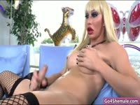 Bodacious blonde tranny Sabrina Lopez models her round bottom and thick meaty cock