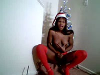 Delightful holiday themed shemale movie featuring Vicki Secret stripping out of hot red lingerie