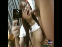 Kinky Asian shemale Vitress Tamayo takes pictures while she treats a lucky stud to a blowjob